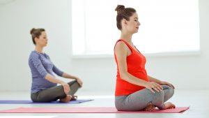 pregnant women attending yoga class