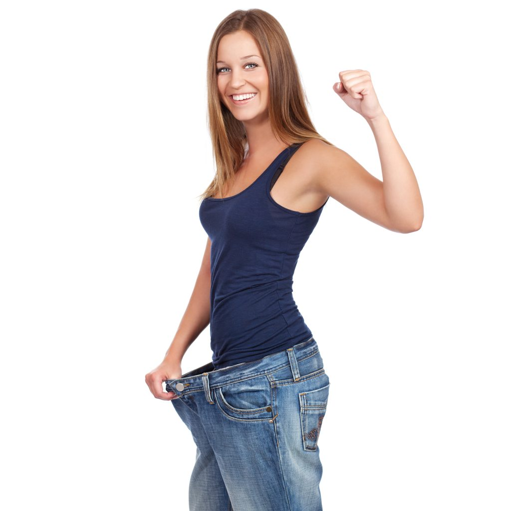 woman showing her weight lost around the waist with raising one arm