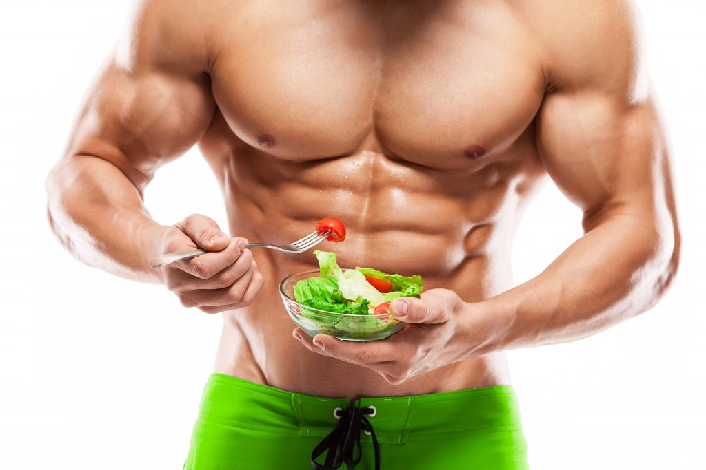 bodybuilder eating healthy meal