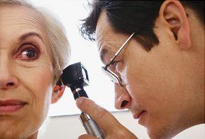 doctor checking tinnitus
